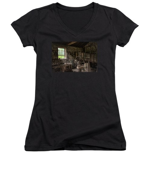 Women's V-Neck T-Shirt (Junior Cut) featuring the photograph Conestoga Wagon At The Blacksmith - Wagon Repair by Gary Heller