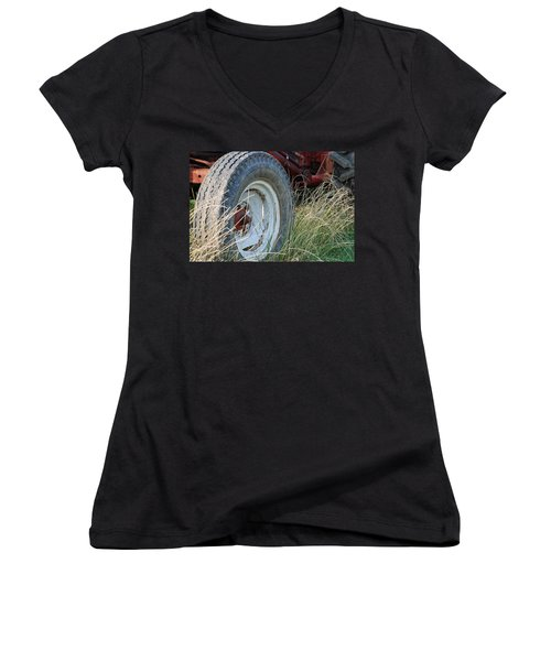 Women's V-Neck T-Shirt (Junior Cut) featuring the photograph Ford Tractor Tire by Jennifer Ancker