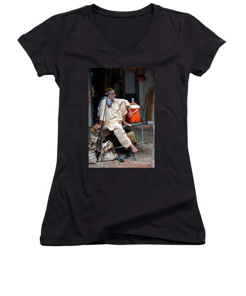 Man Sits And Relaxes In Lahore Walled City Pakistan Women's V-Neck T-Shirt
