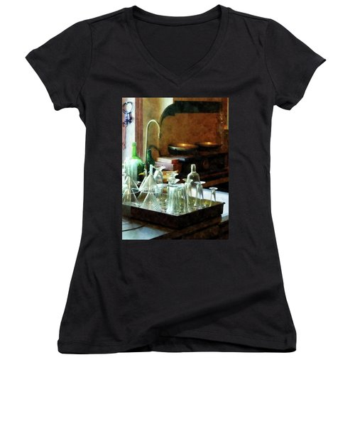 Women's V-Neck T-Shirt (Junior Cut) featuring the photograph Pharmacy - Glass Funnels And Bottles by Susan Savad