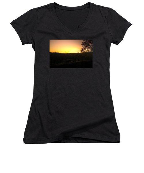 Women's V-Neck T-Shirt (Junior Cut) featuring the photograph Sunset Behind Hills by Jonny D