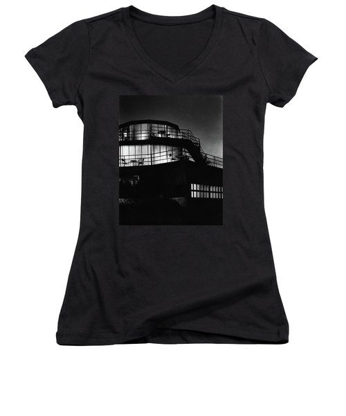 The Exterior Of A Spiral House Design At Night Women's V-Neck