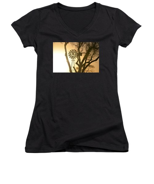 Women's V-Neck T-Shirt (Junior Cut) featuring the photograph Spinning In The Sundown by Clarice  Lakota