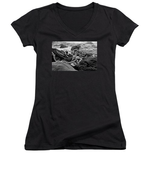 Women's V-Neck T-Shirt (Junior Cut) featuring the photograph Fisherman Sleeping On A Huge Array Of Nets by Tom Wurl