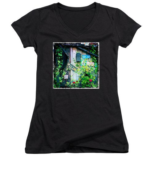 Women's V-Neck T-Shirt (Junior Cut) featuring the photograph License Plate Wall by Nina Prommer