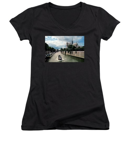 Women's V-Neck T-Shirt (Junior Cut) featuring the photograph Tour Boat Passing Notre Dame by Dave Mills