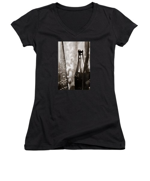 Women's V-Neck T-Shirt (Junior Cut) featuring the photograph Vintage Beer Bottles. by Andrey  Godyaykin
