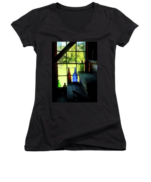 Women's V-Neck T-Shirt (Junior Cut) featuring the photograph Colored Bottles On Steps by Susan Savad