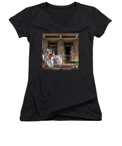 Women's V-Neck T-Shirt (Junior Cut) featuring the photograph Cuban Women Hanging Laundry In Havana Cuba by Charles Harden