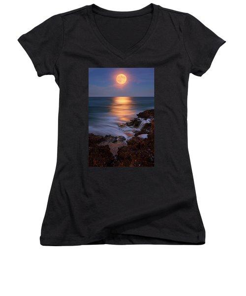 Harvest Moon Rising Over Beach Rocks On Hutchinson Island Florida During Twilight. Women's V-Neck T-Shirt (Junior Cut) by Justin Kelefas