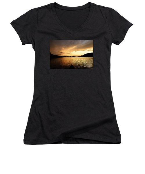 Women's V-Neck T-Shirt (Junior Cut) featuring the photograph Paddling At Sunset On Kekekabic Lake by Larry Ricker