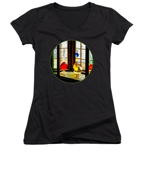Women's V-Neck T-Shirt (Junior Cut) featuring the photograph Pharmacist - Colorful Bottles In Drug Store Window by Susan Savad