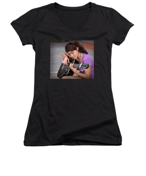 Women's V-Neck T-Shirt (Junior Cut) featuring the photograph The Student by Jim Walls PhotoArtist