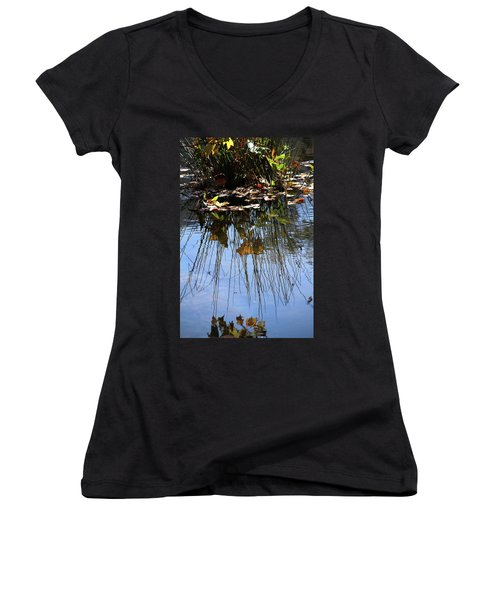 Water Reflection Of Plant Growing In A Stream Women's V-Neck T-Shirt (Junior Cut) by Emanuel Tanjala