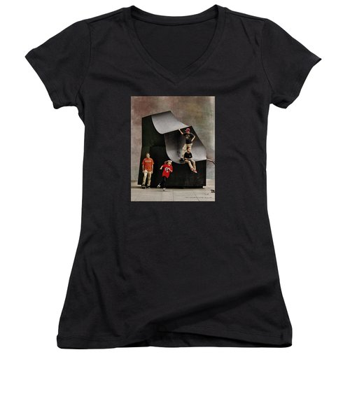 Young Skaters Around A Sculpture Women's V-Neck T-Shirt (Junior Cut) by Pedro L Gili