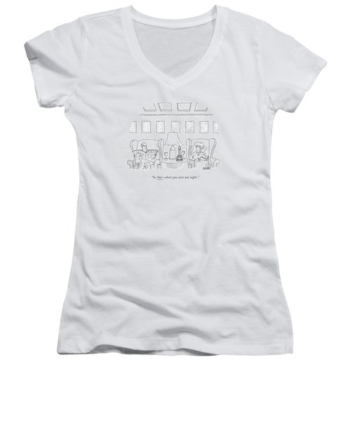 A Man Sits In A Living Room Women's V-Neck