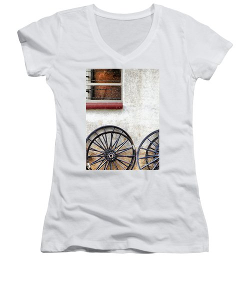 Women's V-Neck T-Shirt (Junior Cut) featuring the photograph Amish Buggy Wheels by Polly Peacock