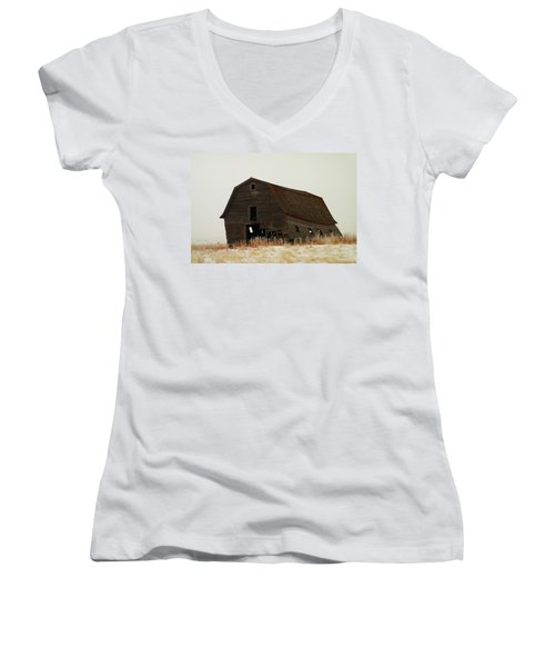 An Old Leaning Barn In North Dakota Women's V-Neck T-Shirt (Junior Cut) by Jeff Swan