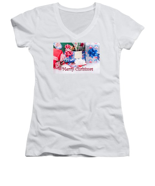 Women's V-Neck T-Shirt (Junior Cut) featuring the photograph Christmas Presents On Artificial Snow by Vizual Studio