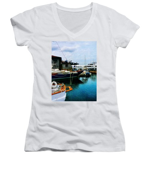 Women's V-Neck T-Shirt (Junior Cut) featuring the photograph Docked Boats In Newport Ri by Susan Savad