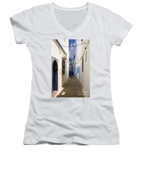 Women's V-Neck T-Shirt (Junior Cut) featuring the photograph Narrow Backstreet In The Medina Of Asilah On Northwest Tip Of Atlantic Coast Of Morocco by Ralph A  Ledergerber-Photography