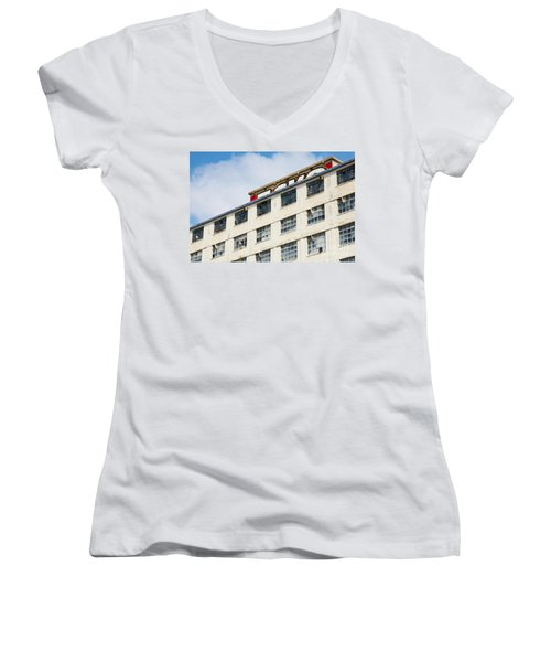 Women's V-Neck T-Shirt (Junior Cut) featuring the photograph Old Factory Under A Clear Blue Sky by Nick  Biemans