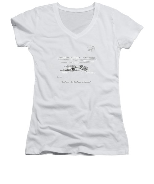Two Men Are On Their Stomachs In A Desert.  One Women's V-Neck