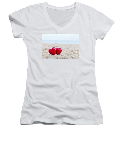 Two Red Hearts On The Beach Symbolizing Love Women's V-Neck T-Shirt