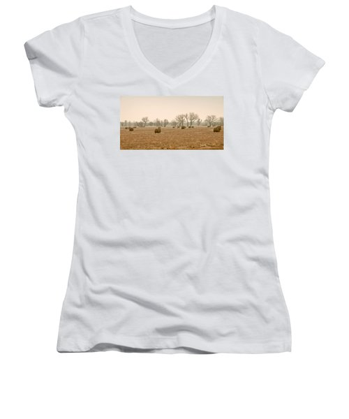 Women's V-Neck T-Shirt (Junior Cut) featuring the photograph Earlying Morning Hay Bails by James Steele