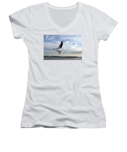 Women's V-Neck T-Shirt (Junior Cut) featuring the photograph White Pelican Flying Over Island by Dan Friend