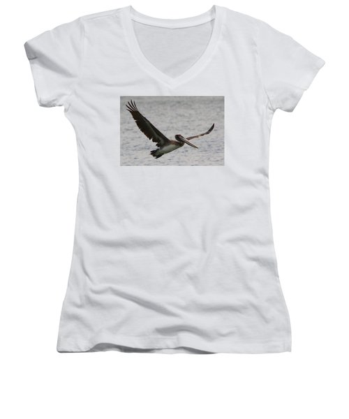 Women's V-Neck T-Shirt (Junior Cut) featuring the photograph Pelican In Flight by Laurel Talabere