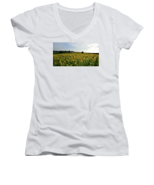 Women's V-Neck T-Shirt (Junior Cut) featuring the photograph A Field Of Sunflowers by Janice Adomeit