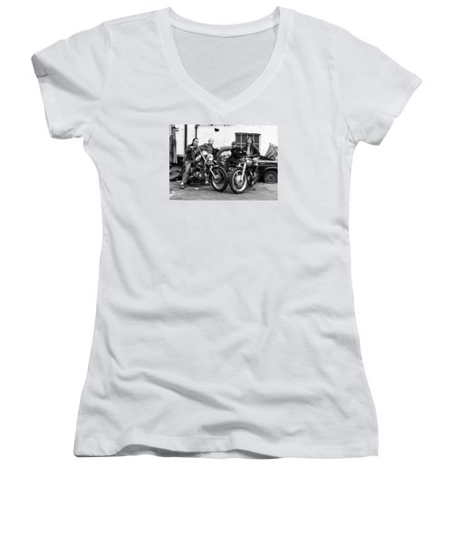 Women's V-Neck T-Shirt (Junior Cut) featuring the photograph A Group Of Women Associated With The Hells Angels, 1973. by Lawrence Christopher
