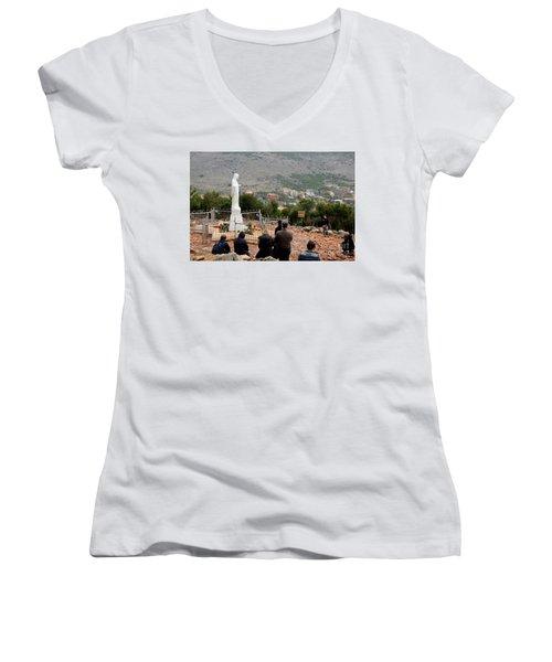 Catholic Pilgrim Worshipers Pray To Virgin Mary Medjugorje Bosnia Herzegovina Women's V-Neck T-Shirt (Junior Cut) by Imran Ahmed