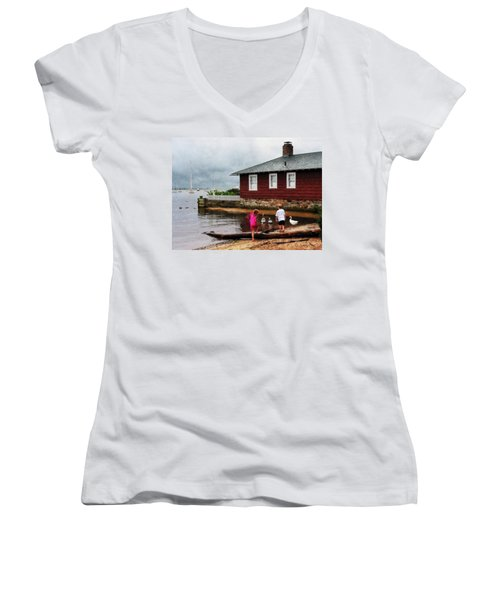 Women's V-Neck T-Shirt (Junior Cut) featuring the photograph Children Playing At Harbor Essex Ct by Susan Savad