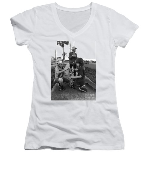 Fixing A Skooter Women's V-Neck T-Shirt (Junior Cut) by WaLdEmAr BoRrErO