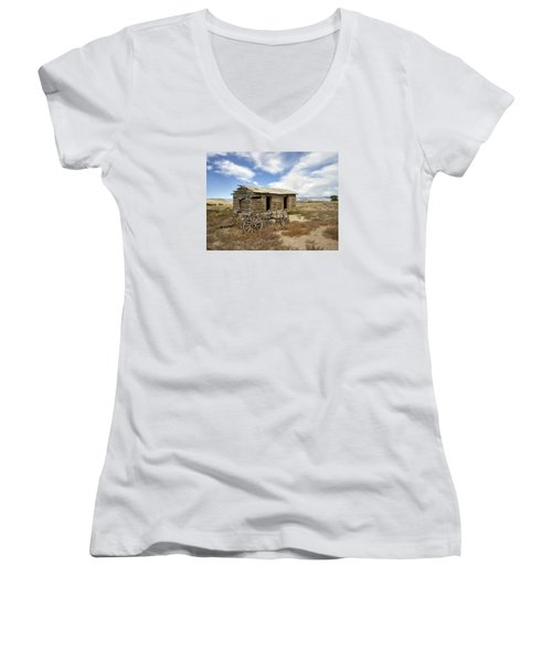 Historic Cabin And Buckboard Wheels In Big Horn County In Wyoming Women's V-Neck T-Shirt