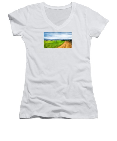 Mountain Biker Cycling Through Green Fields Women's V-Neck T-Shirt