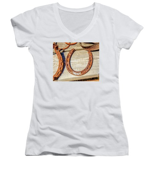 Women's V-Neck T-Shirt (Junior Cut) featuring the photograph Rusty Horseshoes Found By Curators Of The Ghost Town Of St. Elmo by Peter Ciro