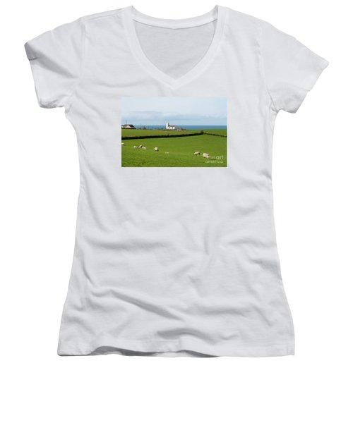 Women's V-Neck T-Shirt (Junior Cut) featuring the photograph Sheep Grazing On Irish Coastline by Juli Scalzi