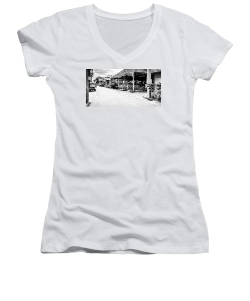 Women's V-Neck T-Shirt (Junior Cut) featuring the photograph Street Scene On Caye Caulker by Lawrence Burry
