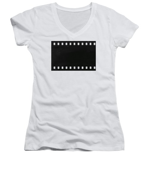 Women's V-Neck T-Shirt (Junior Cut) featuring the photograph Strip Of Old Celluloid Film With Dust And Scratches by Michal Boubin