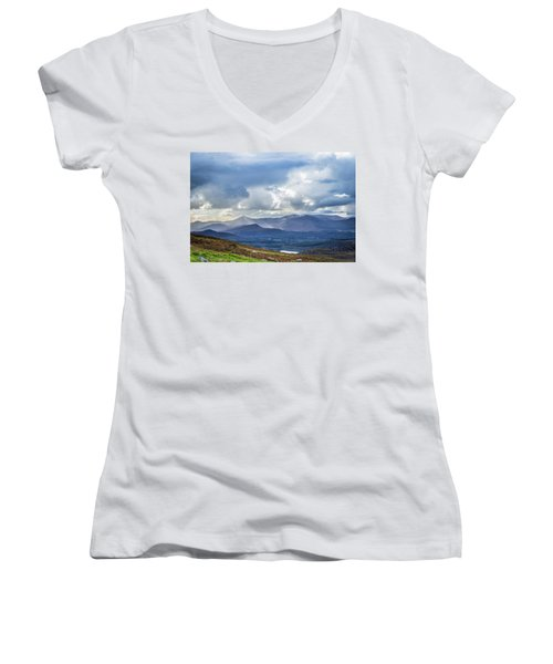 Women's V-Neck T-Shirt (Junior Cut) featuring the photograph Sun Rays Piercing Through The Clouds Touching The Irish Landscap by Semmick Photo