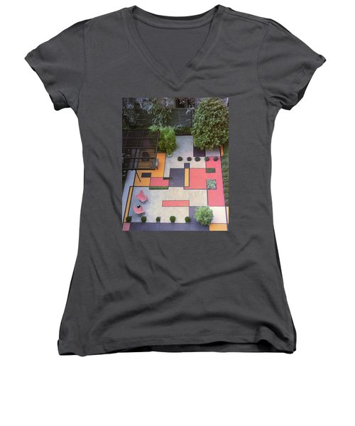 A Garden With Colourful Landscaping In Dr Women's V-Neck