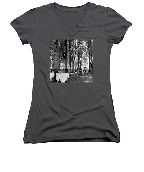 A Group Of People Eating Lunch Under Trees Women's V-Neck