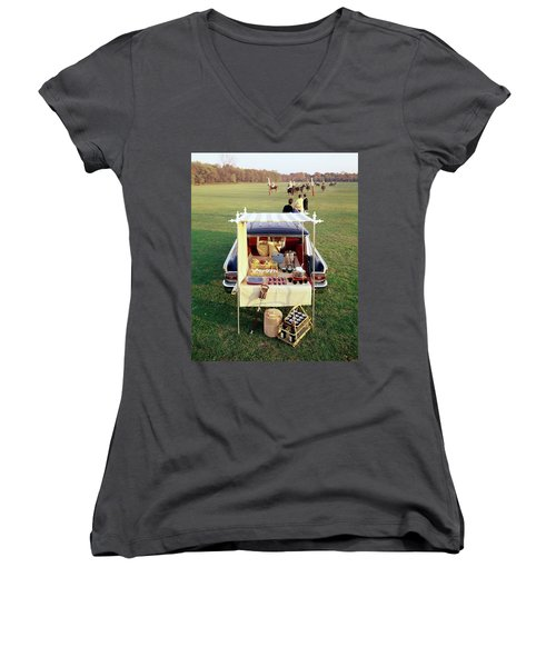 A Picnic Table Set Up On The Back Of A Car Women's V-Neck