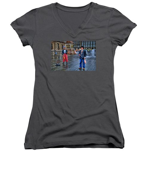 Women's V-Neck T-Shirt (Junior Cut) featuring the photograph City Jugglers by Ron Shoshani
