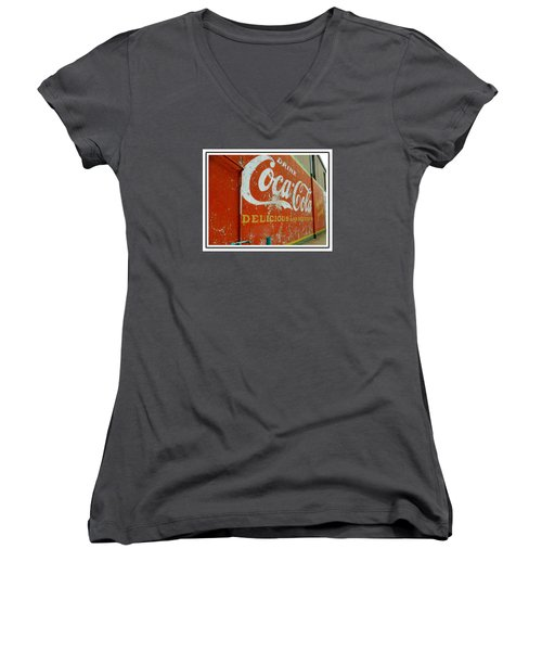 Women's V-Neck T-Shirt (Junior Cut) featuring the photograph Coca-cola On The Army Store Wall by Kathy Barney