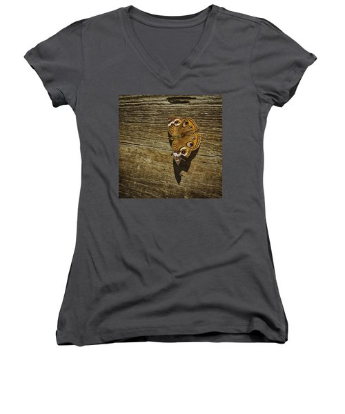 Women's V-Neck T-Shirt (Junior Cut) featuring the photograph Common Buckeye With Torn Wing by Lynn Palmer
