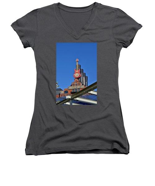 Women's V-Neck T-Shirt (Junior Cut) featuring the photograph Hard Rock Cafe - Baltimore by Jean Goodwin Brooks